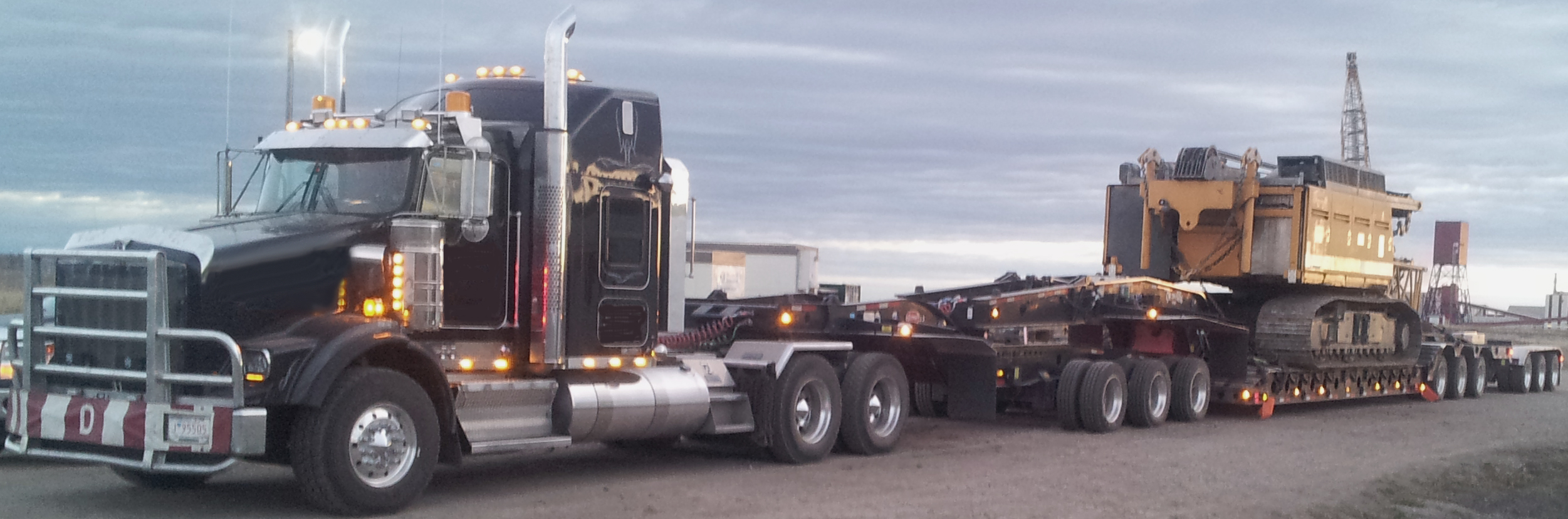 13 axle step deck heavy haul transporting.